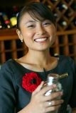 Bartender. Asian woman bartender at work stock photo