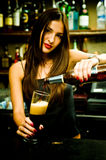 Bartender. A young female bartender, photographed at work Royalty Free Stock Photography
