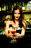 Bartender. A young female bartender, photographed at work Royalty Free Stock Images