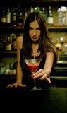 Bartender. A young female bartender, photographed at work Royalty Free Stock Photo
