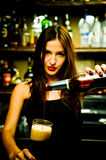 Bartender. A young female bartender, photographed at work Stock Photos