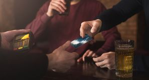 Bartender accepting credit card at bar counter. Bartender accepting credit card at counter in bar. Cashless payment, modern technologies in every day life, copy royalty free stock photography