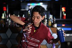 Bartender in actionn Stock Photos