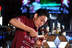 Bartender in actionn Stock Images
