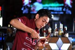 Bartender in actionn Stock Images