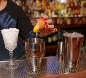 Bartender is adding egg to the glass stock image