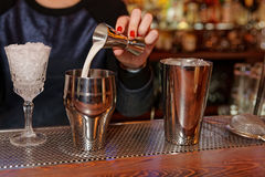 Bartender is adding milk to the shaker Royalty Free Stock Images