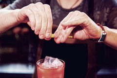 Bartender is adding zest to cocktail Stock Photography
