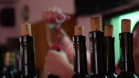 Bartender at the bar corkscrew video opens wine