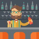Bartender at the bar holding a drinks Royalty Free Stock Photo