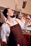 The bartender or barista juggles with a metal shaker. Bartender show Stock Photo