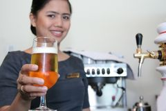 Bartender and beer royalty free stock photo