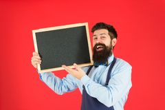 Bartender with blackboard. Hipster bartender show blackboard copy space. Hipster restaurant staff. Hipster informing you. Man bearded bartender or cook in royalty free stock photos