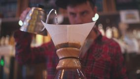 The bartender brews coffee. Aternative ways of making coffee stock video footage