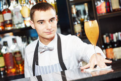 Bartender with coctail at bar stock images