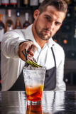 Bartender decorating cocktail Royalty Free Stock Photo