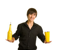 Bartender does a trick with a shaker and bottle Royalty Free Stock Photography