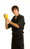 Bartender does a trick with a shaker and bottle Stock Images