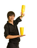 Bartender does a trick with a shaker and bottle Stock Photos