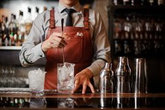 Bartender is making make a cocktail with ice Royalty Free Stock Photography
