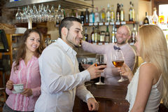 Bartender entertaining guests Royalty Free Stock Image