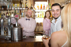 Bartender entertaining guests Stock Photography