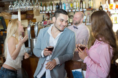 Bartender entertaining guests Stock Images