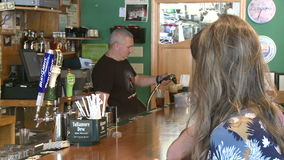 Bartender filling beer on draught. Typical scene of people Dining stock video