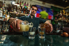 The bartender fills the glasses Stock Photo