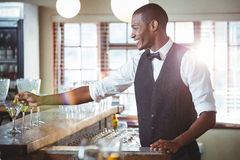 Bartender garnishing cocktail with olive Royalty Free Stock Photo