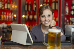 Bartender girl behind the counter Royalty Free Stock Photo