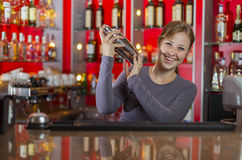 Bartender girl behind the counter Stock Images