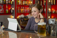 Bartender girl behind the counter Royalty Free Stock Images