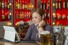 Bartender girl behind the counter Stock Photos