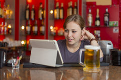 Bartender girl behind the counter Royalty Free Stock Photography