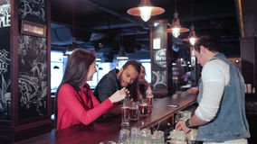 The bartender gives the drink tube in two fun girl stock video footage