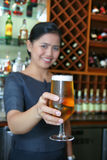 Bartender giving the beer royalty free stock photography