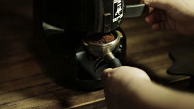 Bartender grinding coffee for espresso in stock video