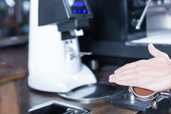 Bartender hand with holder Royalty Free Stock Photo