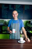 Bartender holding coffee cup Royalty Free Stock Image