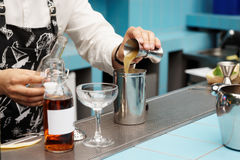 Bartender Is Pouring Infusion Into Mixing Glass Royalty Free Stock Photos