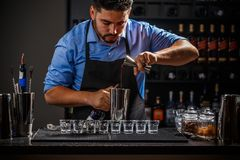 Bartender with jigger Stock Photography