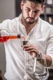 Bartender make a cocktail Stock Photos