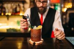 Bartender making alcohol beverage with gas burner Stock Photo