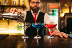 Bartender making alcohol beverages in nightclub Royalty Free Stock Photo