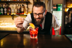 Bartender making alcohol coctail in restaurant Stock Photography