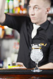 Bartender is making cocktail Royalty Free Stock Photography