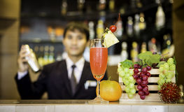 Bartender is making cocktail Royalty Free Stock Image