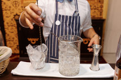 Bartender is making cocktail at bar counter Stock Photos