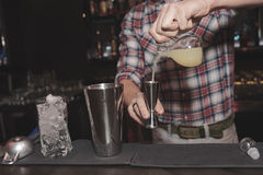Bartender is making cocktail, toned image Stock Photos